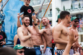 Happy guys at gay pride parade in Sitges — Stock Photo