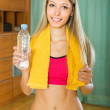 Girl with towel and bottle of water — Stock Photo #52527475