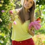 Smiling woman in yard gardening — Stock Photo #52527795
