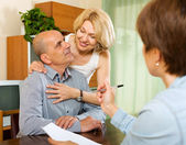 Mature couple with insurance agent — Stock Photo