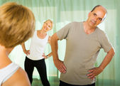 Senior people on fitness with instructor — Stock Photo