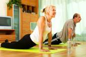 Pensioners doing exercises indoor — Stock Photo