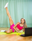 Girl working out with notebook — Stock Photo