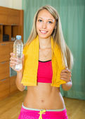 Girl with towel and bottle of water — Stock Photo