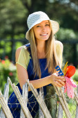 Happy woman  in uniform at yard gardening — Stock Photo