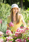 Gardener walking near flowering shrubs — Stock Photo