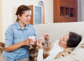daughter caring for sick mature mother   — Stock Photo