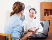 Smiling mature woman questionnaire for  social worker   — Stock Photo