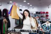 Smiling girl at clothing store — Stock Photo