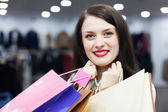 Ordinary woman with shopping bags — Stock Photo