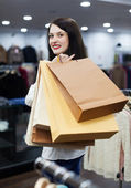 Girl with bags at fashion boutique — Stock Photo