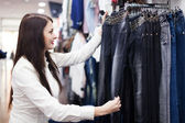 Woman choosing jeans — Stock Photo