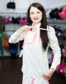 Woman choosing underwear at boutique — Stock Photo