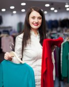 Smiling buyer at fashionable shop — Stock Photo