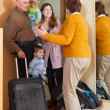 Happy family coming to grandmother — Stock Photo #52532899