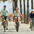 Couple with son on bicycles — Stock Photo #52533147