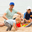 Parents with kids at seaside — Stock Photo #52533177