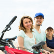 Smiling parents with kid having rest — Stock Photo #52533179