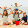 Parents with kids at seaside — Stock Photo #52533225