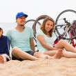 Parents and son with bicycles on sand — Stock Photo #52533255
