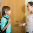 Mother with son at doorway — Stock Photo #52533959