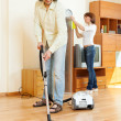 Couple cleaning with vacuum cleaner   — Stock Photo #52534217