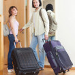 Two tourists with luggage near door  — Stock Photo #52534415