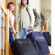 Man and woman with luggage leaving home — Stock Photo #52534425