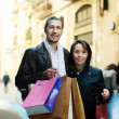 Couple with shopping bags at european street — Stock Photo #52535673