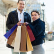 Couple with shopping bags at european street — Stock Photo #52535689