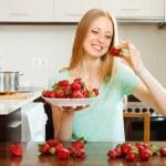 Happy  woman eating strawberry — Stock Photo #52536019