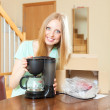 Woman with new  coffee maker — Stock Photo #52536075