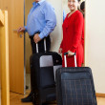 Senior tourists with baggage — Stock Photo #52537289