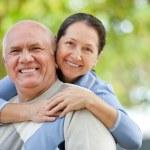Senior couple in park — Stock Photo #52537529
