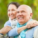 Senior couple in park — Stock Photo #52537561