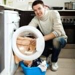 Man with washing machine — Stock Photo #52537705