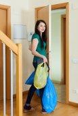 Brunette woman taking away the garbage   — Stock Photo