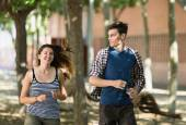 Sportive young couple running outdoor — Stockfoto