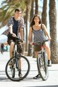 Man and woman riding bicycles on the street  — Stock Photo