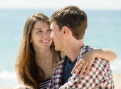 Couple on sandy beach — Stock Photo