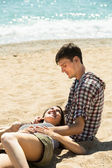 girl is lying on the lap of a young man  — Stock Photo