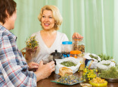 Two mature women with  herbs — Stock Photo