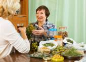 Two mature pensioner with  herbs — Stock Photo