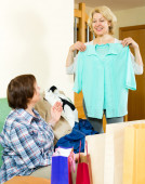 Two women checking purchases — Stock Photo