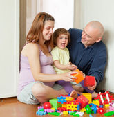 Happy parents plays with child — Stock Photo