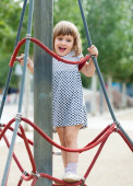 Girl at playground area in  summer — Stock Photo