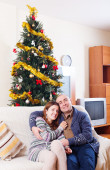 Loving couple near Christmas tree  — Stock Photo