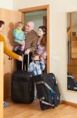 Family of four coming   home — Stock Photo
