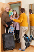 Happy family coming to grandmother — Stock Photo