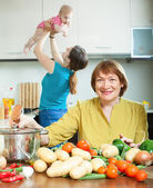 Women of three generations in domestic kitchen — Stock Photo